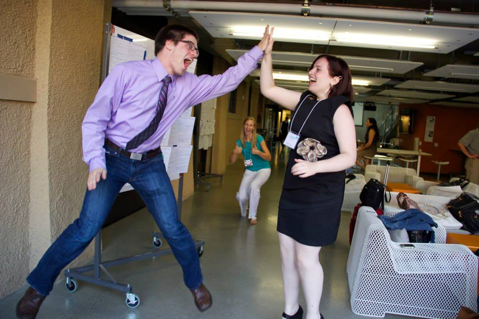 High energy and high fives at the Epicenter Research Summit (2014) with co-presenters Elliot Roth and Bre Przestrzelski.